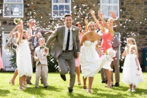 newly wed running with confetti throwing at them