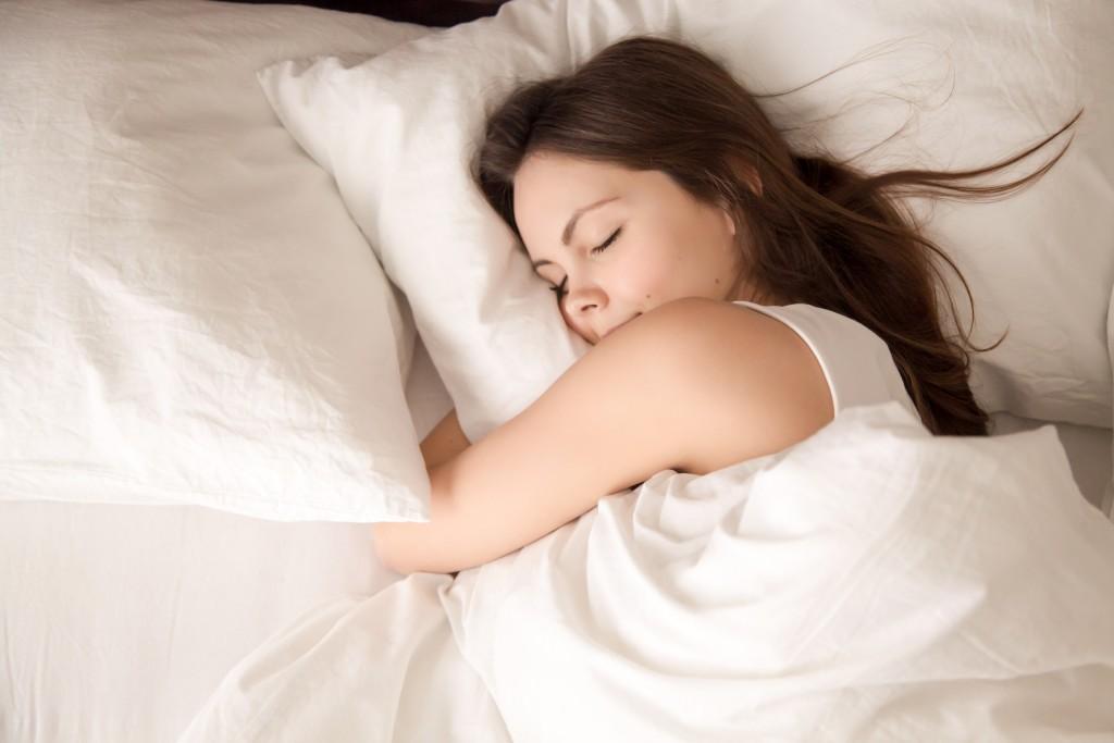 Female sleeping on bed