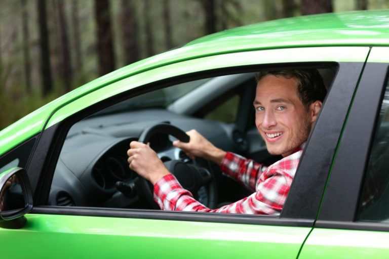 Man driving green car