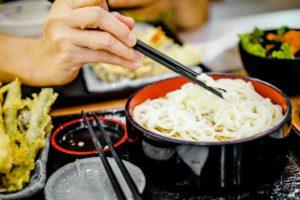 person having japanese food