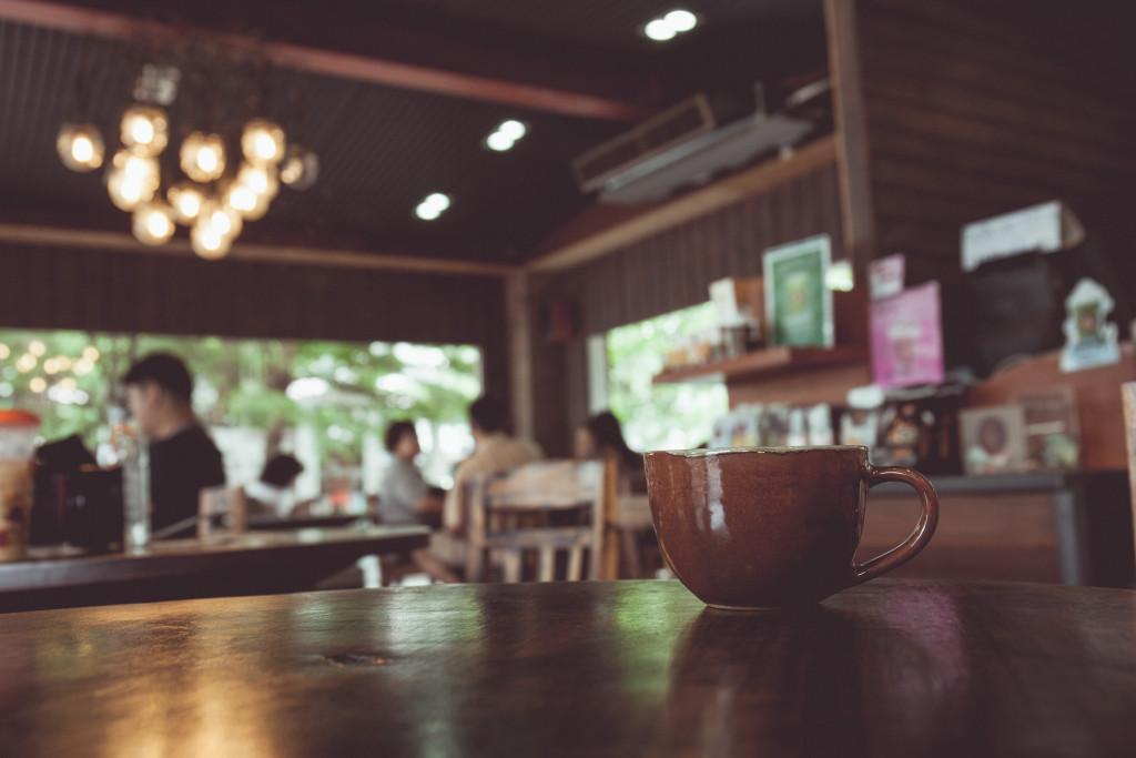 vintage tone of cup of coffee on table in a coffee shop