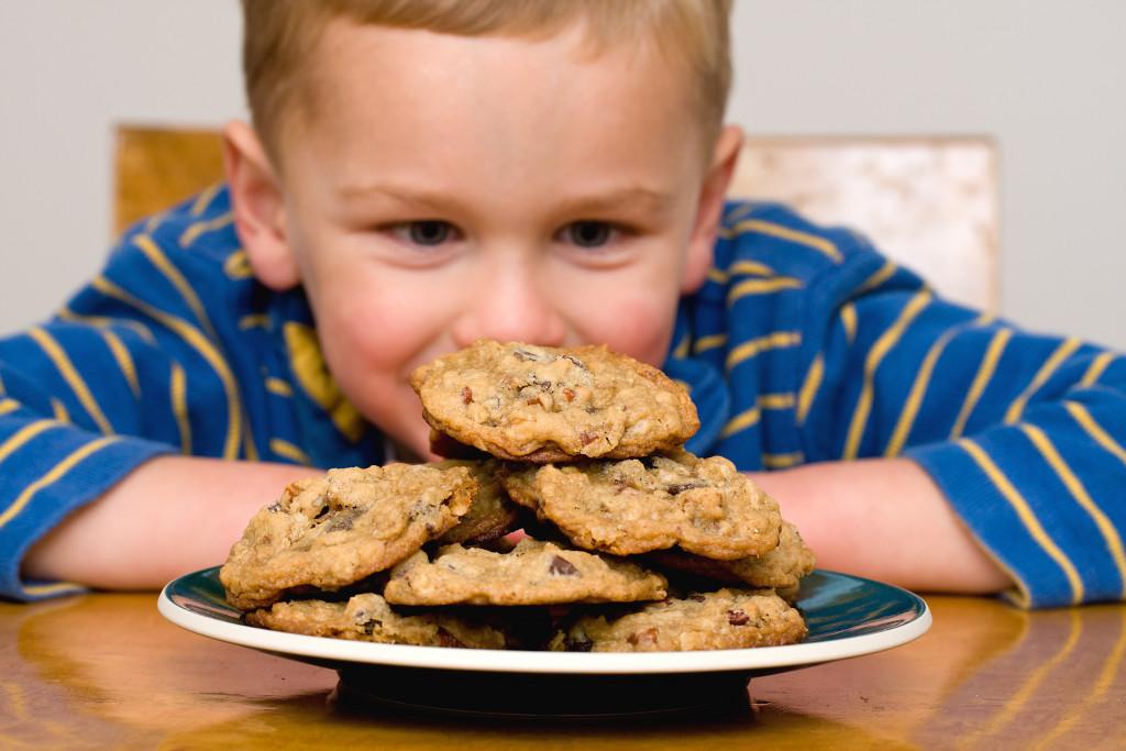 kid looking at cookies