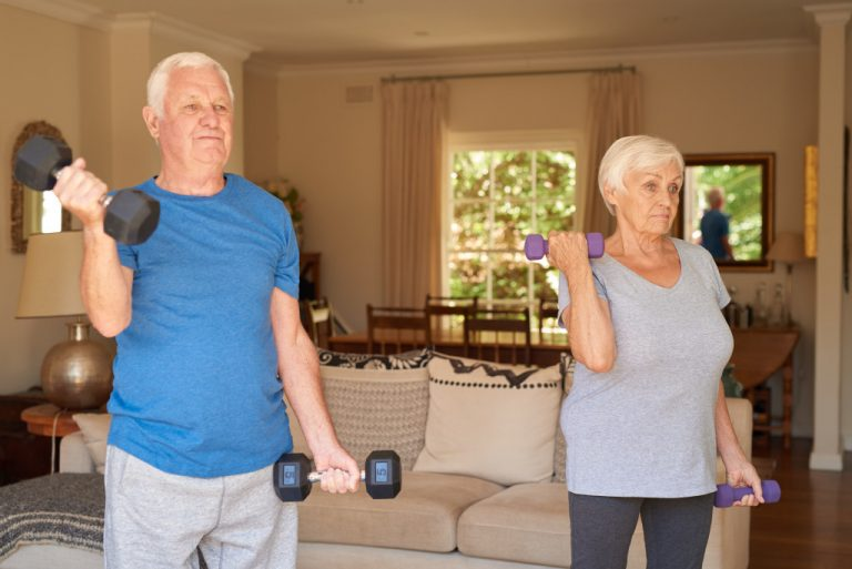mature couple lifting weights