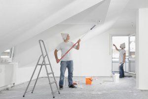 men repainting walls